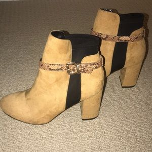 Tan booties with snake skin accent buckle!